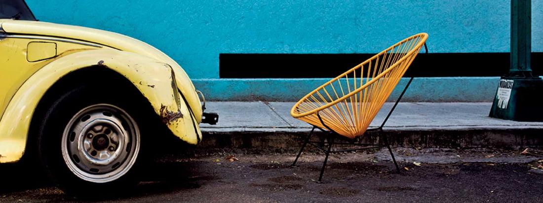 Der Acapulco Chair von Acapulco Design fällt durch seine außergewöhnliche Sitzschale aus Leder auf. Produziert wird der bequeme Retro-Stuhl in Mexico-City.
