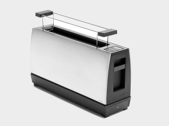 Der One Slot II von Jacob Jensen zeichnet sich durch eine einfache und klare Formensprache aus. Ein Einschlitztoaster für zwei Scheiben mit vielen technischen Spielerein.