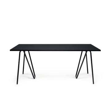 Gebogenes Stück Stahl als Tischbock