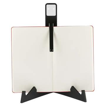 Moleskine - LED Leseleuchte, schwarz - am Buch